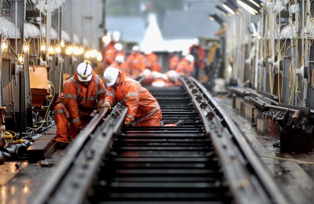 Engineers working to repair the railway on a bridge