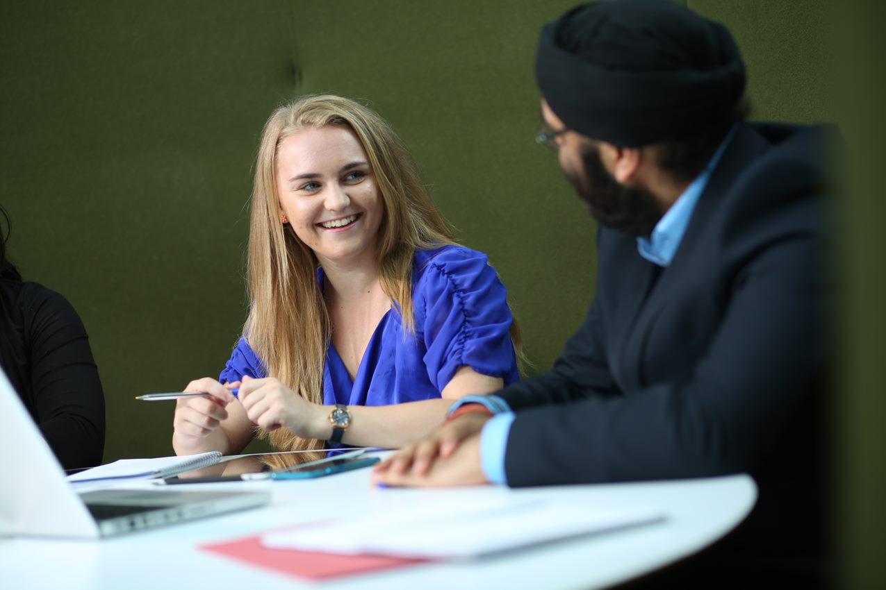 Network Rail apprentices sat at an office desk